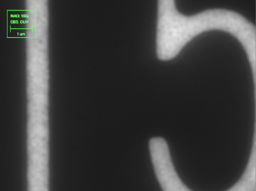 DUV microscope image with 1µm scale bar